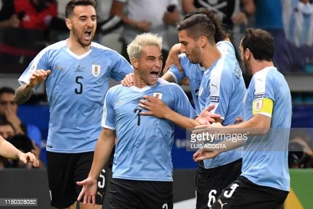 TOPSHOT Uruguay's Nicolas Lodeiro celebrates with teammates after scoring against Ecuador during their Copa America football tournament group match...