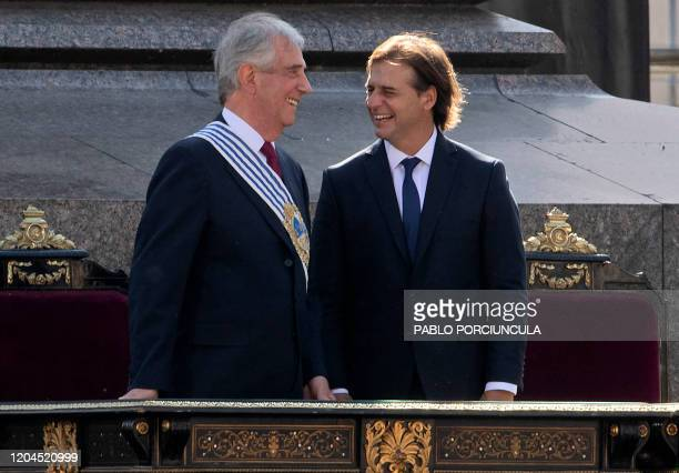 Uruguay's outgoing President Tabare Vazquez and incoming President Luis Lacalle Pou smile during the inauguration ceremony at the Plaza Independencia...