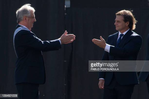 Uruguay's outgoing President Tabare Vazquez greets the incoming President Luis Lacalle Pou during the inauguration ceremony at the Plaza...