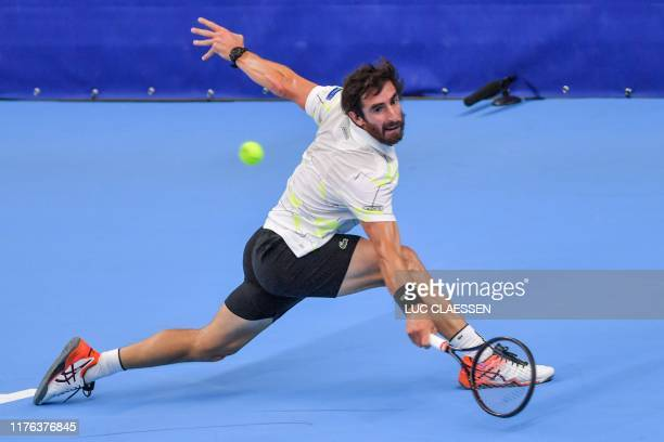 Uruguay's Pablo Cuevas returns a shot during a tennis match against Britain's Andy Murray in the second round of the men's singles tournament at the...