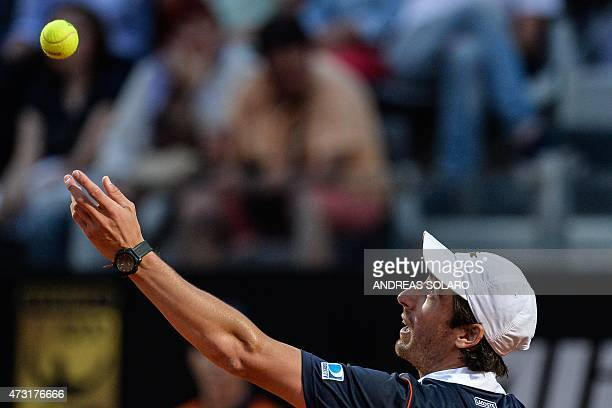 Uruguay's Pablo Cuevas serves the ball to Swiss tennis player Roger Federer during the ATP Tennis Open tournament at the Foro Italico in Rome on May...