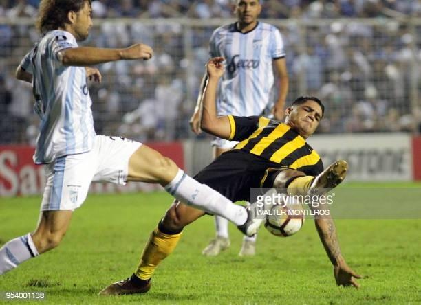TOPSHOT Uruguay's Penarol Gabriel Fernandez vies for the ball with Rafael Garcia of Argentina's Atletico Tucuman during the 2018 Copa Libertadores...
