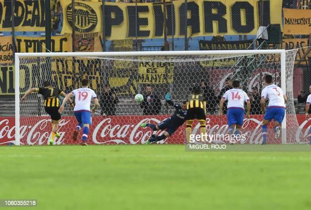 Uruguay's Penarol midfielder Cristian Rodriguez shoots a penalty kick to score the second goal against Uruguay's Nacional during the 2018 Uruguayan...