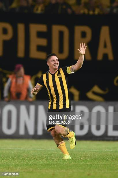 Uruguay's Penarol player Cristian Rodriguez celebrates after scoring a goal against Argentina's Atletico Tucuman during their Libertadores Cup...