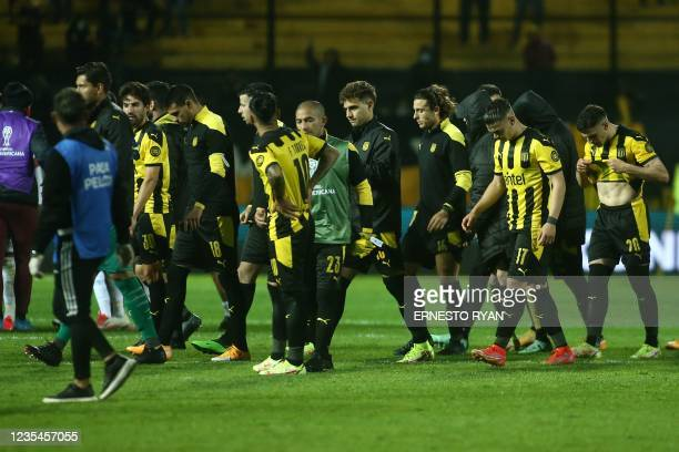 Uruguay's Penarol players react at the end of the Copa Sudamericana semi-final first leg football match against Brazil's Athletico Paranaense, at the...