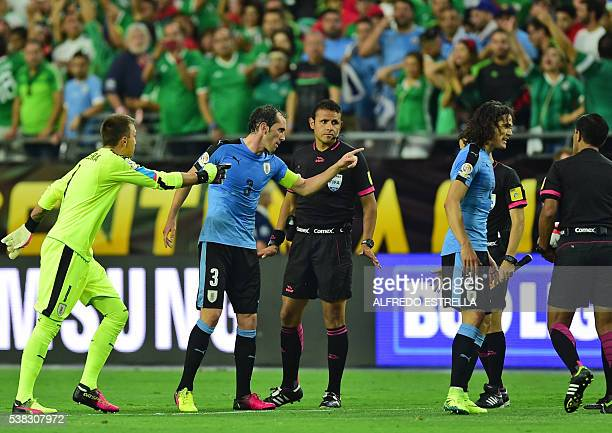 Uruguay's player Fernando Muslera Diego Godin and Edinson Cavani argue with the referees at the end of the Copa America Centenario football...