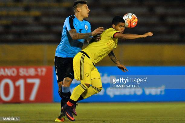 Uruguay's player Mathias Olivera vies for the ball with Colombia's player Juan Camilo Hernandez during their South American Championship U20 football...
