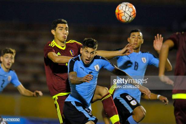 Uruguay's player Mathias Olivera vies for the ball with Venezuela's player William Velasquez during their South American Championship U20 football...