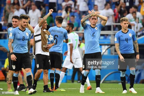 Uruguay's players celebrate at the end of the Russia 2018 World Cup Group A football match between Uruguay and Saudi Arabia at the Rostov Arena in...