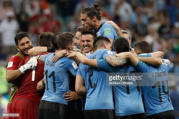 TOPSHOT Uruguay's players celebrate their win during the Russia 2018 World Cup round of 16 football match between Uruguay and Portugal at the Fisht...
