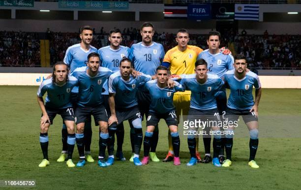 Uruguay's players pose for pictures ahead of the internatioanl friendly football match between Uruguay and Costa Rica at National stadium in San...