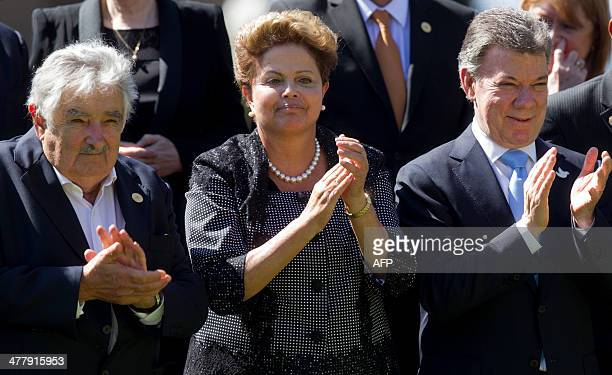 Uruguay's President Jose Mujica Brazil's Dilma Rousseff and Colombia's Juan Manuel Santos applaud during the family photo at Cerro Castillo Palace in...