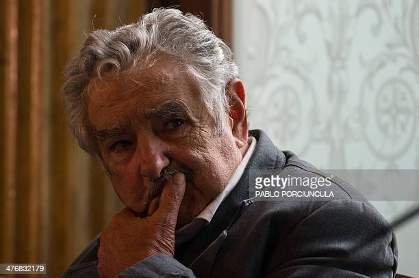 Uruguay's President Jose Mujica gestures during a ceremony at Palacio Santos in Montevideo on March 5 2014 Mujica and Chilean activist and mother of...