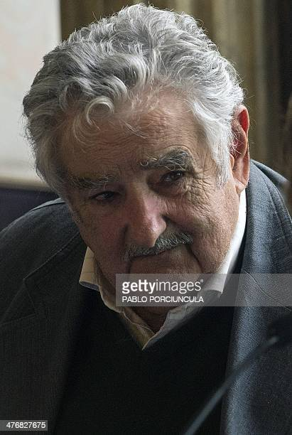Uruguay's President Jose Mujica listens to Chilean activist and mother of Chile's Presidentelect Michelle Bachelet Angela Jeria de Bachelet during a...