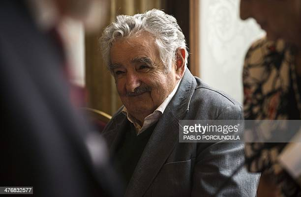 Uruguay's President Jose Mujica smiles during a ceremony at Palacio Santos in Montevideo on March 5 2014 Mujica and Chilean activist and mother of...