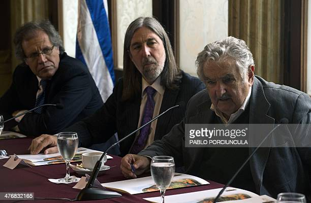 Uruguay's President Jose Mujica speaks next to Chilean senator Juan Pablo Letelier and Uruguayan Foreign Affairs Minister Luis Almagro during a...