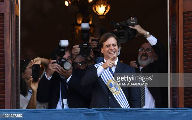 Uruguay's President Luis Lacalle Pou greets the crowd during his inauguration ceremony at the Plaza Independencia in Montevideo on March 1 2020