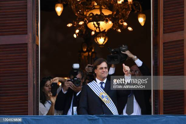 Uruguay's President Luis Lacalle Pou waves from the balcony of the Palacio Estevez during the inauguration ceremony at the Plaza Independencia in...