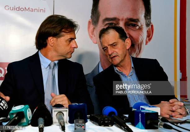 Uruguays presidential candidate for the Nacional party Luis Lacalle Pou and former presidential candidate Guido Manini Rios of the right wing Cabildo...