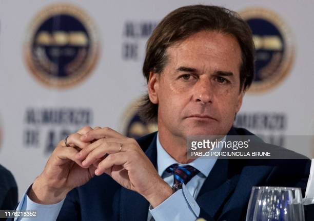 Uruguay's presidential candidate Luis Lacalle Pou of the opposition Partido Nacional party gestures as he attends a forum with businessmen in...