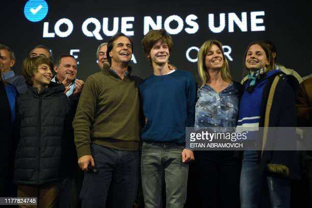 Uruguay's presidential candidate Luis Lacalle Pou of the opposition Partido Nacional party his wife Lorena Ponce de Leon and their children Manuel...