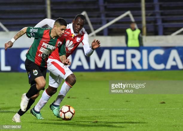 Uruguay's Rampla Juniors forward Juan Ignacio Panzariello and Colombia's Independiente Santa Fe defender Javier Lopez vie for the ball during their...