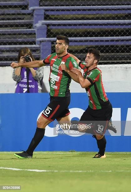 Uruguay's Rampla player Julian Lalinde celebrates with teammate Igor Paim a goal against Peru's Cajamarca during their Copa Sudamericana football...