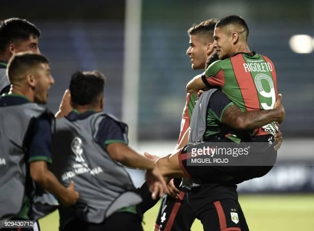 Uruguay's Rampla player Matias Rigoleto celebrates with teammates after scoring a goal against Peru's Cajamarca during their Copa Sudamericana...
