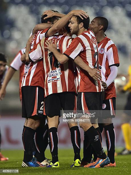 Uruguay's River Plate's players celebrate their victory over Chile's Universidad Catolica during their Copa Sudamericana football match at the San...