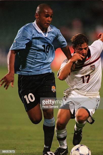 Uruguay's Ruben Olivera holds back USA's Serth Trembly in the FIFA under 17 World Championship at North Harbour Stadium Albany TuesdayUSA won 10