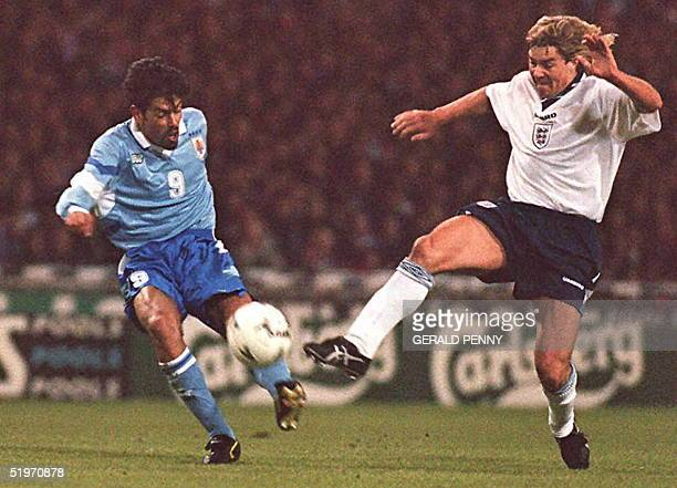 Uruguay's striker Daniel Fonseca goes close with a first half shot, 29 March, with England midfielder Barry Venison in persuit at Wembley Stadium...