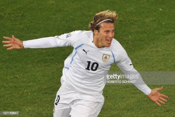 Uruguay's striker Diego Forlan celebrates after scoring during their Group A first round 2010 World Cup football match on June 16 2010 at Loftus...