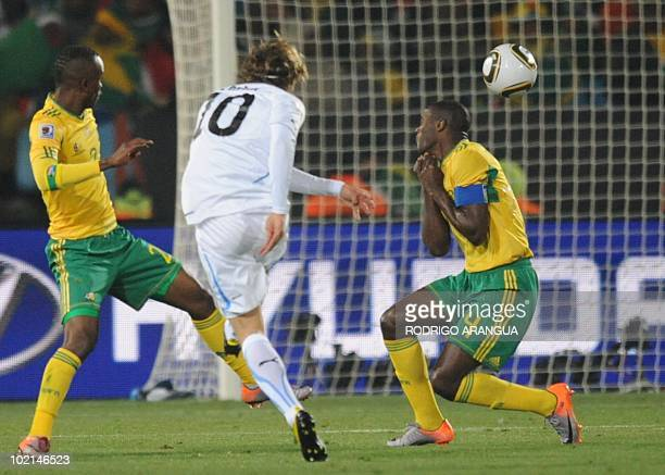 Uruguay's striker Diego Forlan scores the opening goal during the Group A first round 2010 World Cup football match South Africa vs Uruguay on June...