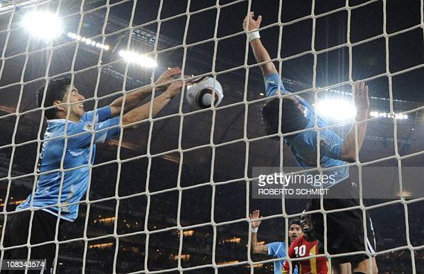 Uruguay's striker Luis Suarez stops the ball with the hand leading to a red card and a penalty for Ghana during the extra-time of 2010 World Cup...