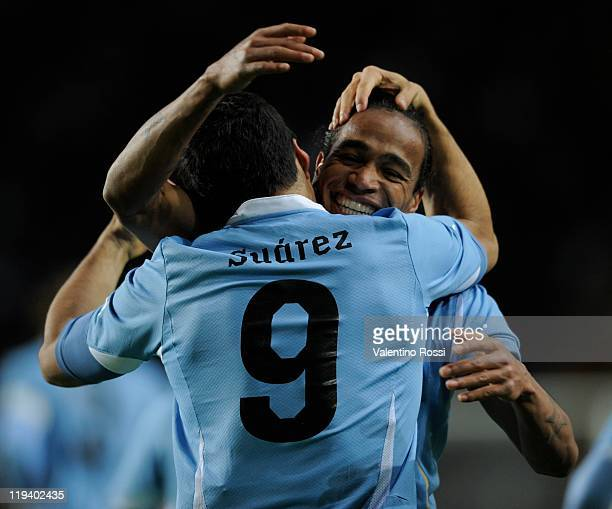 Uruguay's Luis Suárez celebrate his second goal with the teammate Álvaro Pereira after scoring against Uruguay during 2011 Copa America soccer match...