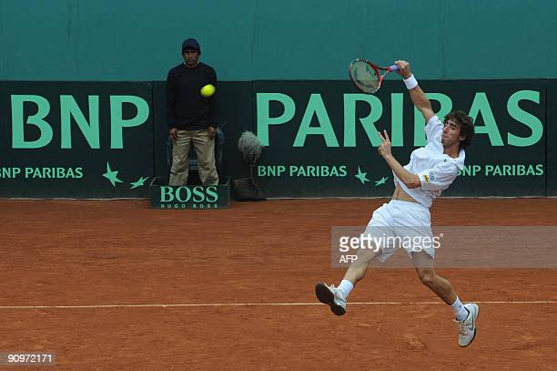 Uruguay's tennis player Pablo Cuevas hits the ball during his Davis Cup's Americas Zone Group 1 Doubles match in Lima on September 19 2009 Uruguay's...