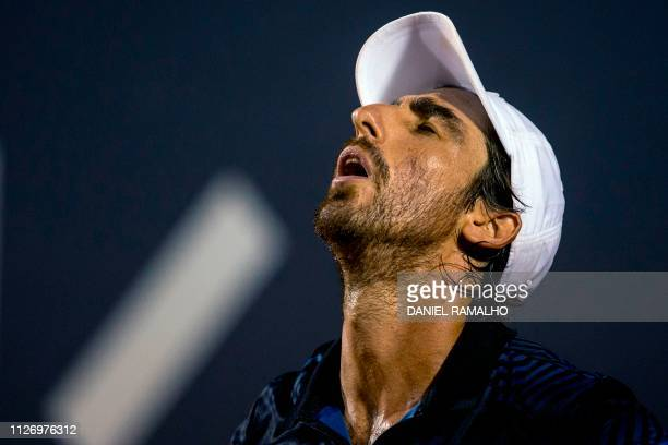 Uruguay's tennis player Pablo Cuevas reacts during the ATP World Tour Rio Open singles semi-final match against Canada's Felix Auger-Aliassime at the...