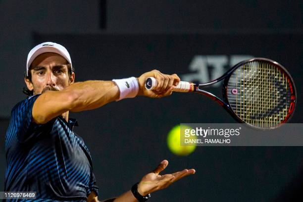 Uruguay's tennis player Pablo Cuevas returns the ball to Canada's Felix AugerAliassime during the ATP World Tour Rio Open singles semifinal match at...