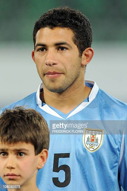 Uruguay's Walter Gargano listens to the national anthems ahead of the World Cup 2010 friendly football match Switzerland vs Uruguay at AFG Arena...