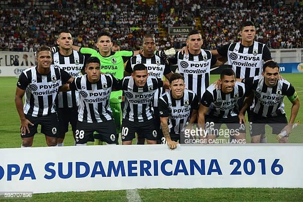 Uruguay's Wanderers team players pose before the Sudamericana Cup football match against Venezuela's Zamora at the La Carolina stadium in Barinas...