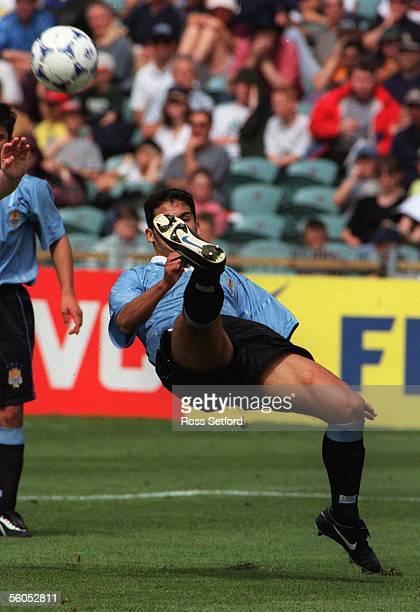 Uruguay's Washington Alfonso scissor kicks against New Zealand in the FIFA under 17 World Championship at North Harbour Stadium Albany Saturday...