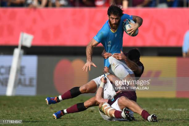 TOPSHOT Uruguay's wing Rodrigo Silva is tackled during the Japan 2019 Rugby World Cup Pool D match between Georgia and Uruguay at the Kumagaya Rugby...