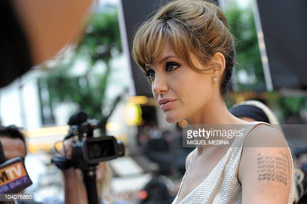 Us actress Angelina Jolie listens to journalists' question at the preview of the film Salt on August 17 2010 in Paris AFP PHOTO MIGUEL MEDINA