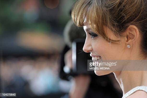 Us actress Angelina Jolie smiles upon her arrival prior to the preview of the film 'Salt' on August 17 2010 in Paris AFP PHOTO MIGUEL MEDINA