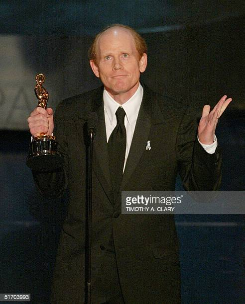 Us director Ron Howard accepts his Oscar for best achievement in directing for 'A Beautiful Mind' during the 74th Academy Awards at the Kodak Theater...