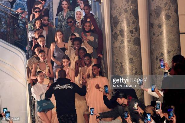 TOPSHOT Us fashion designer Virgil Abloh for OffWhite acknowledges the audience at the end of the OffWhite's 2018/2019 fall/winter collection fashion...