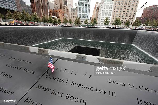 A us flag at the memorial wall on the South Tower pool of the World Trade Center on September 11 2011 in New York as the US marks 10 years since the...