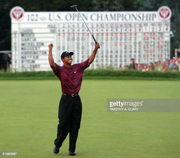 Us golfer Tiger Woods celebrates his win on the 18th green 16 June in the 2002 US Open Championship at Bethpage Black in Farmingdale NY AFP...