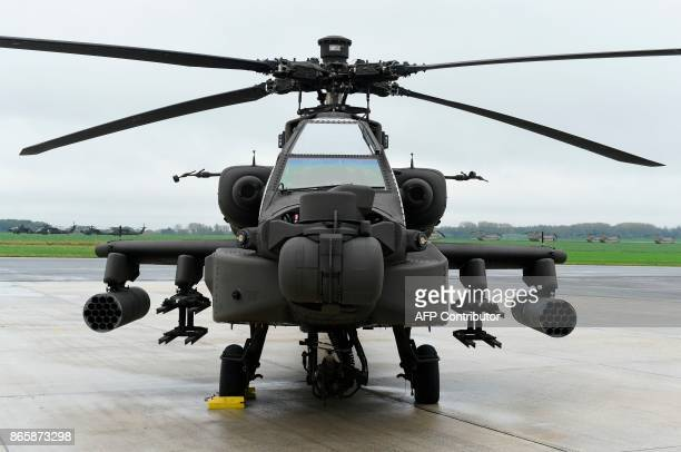 Us helicopters AH64 Apache is pictured on the tarmac at Shape Airfield at Chievres Air Base in Belgium on October 24 2017 The 1st Cavalry Brigade...