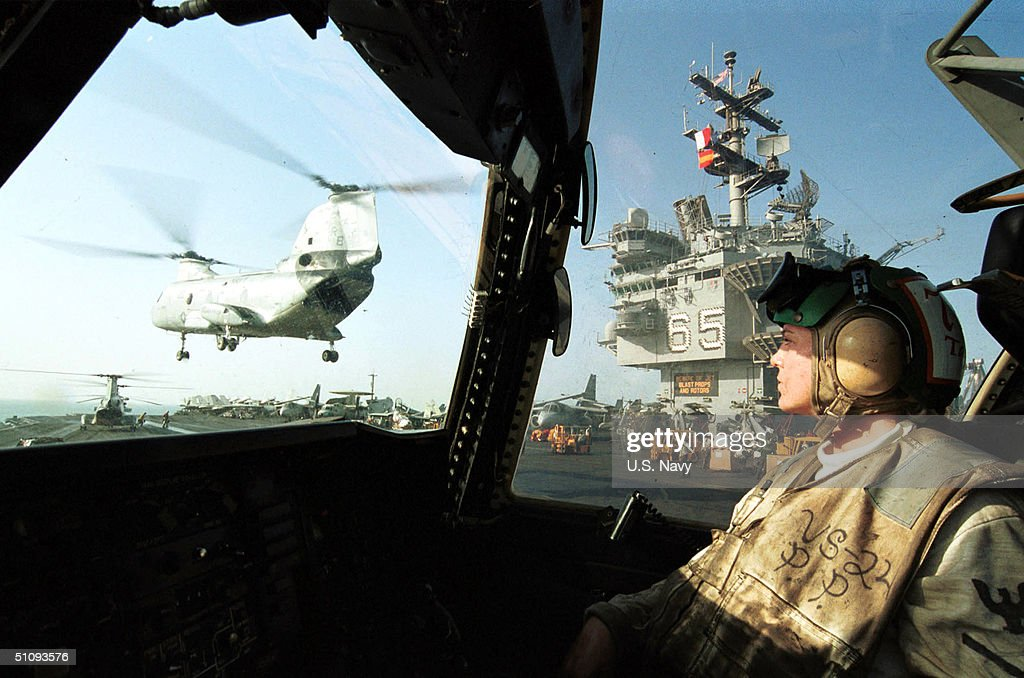US Navy Aviation Machinist Mate Watches A Ch 46 Sea Knight Fly By ...